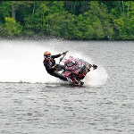 US Chrome Snowmobile On Water